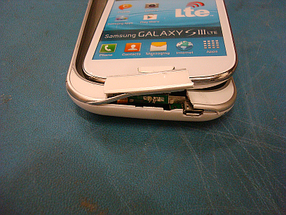 This shows an example of damage done to a cell phone after a drop test.